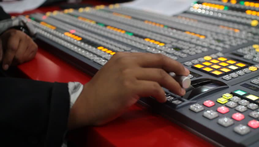 Professional video switcher setup video switching board before live television broadcast  | Shutterstock HD Video #14012882