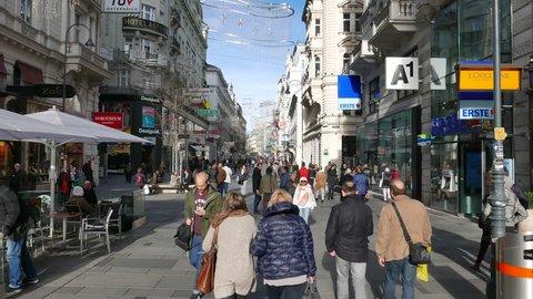 VIENNA -NOV 10, 2015: People on Karntner street (Karntnerstrasse), Vienna, Austria. Karntner Strasse (Carinthian Street) is one of the most famous shopping street in central Vienna.
