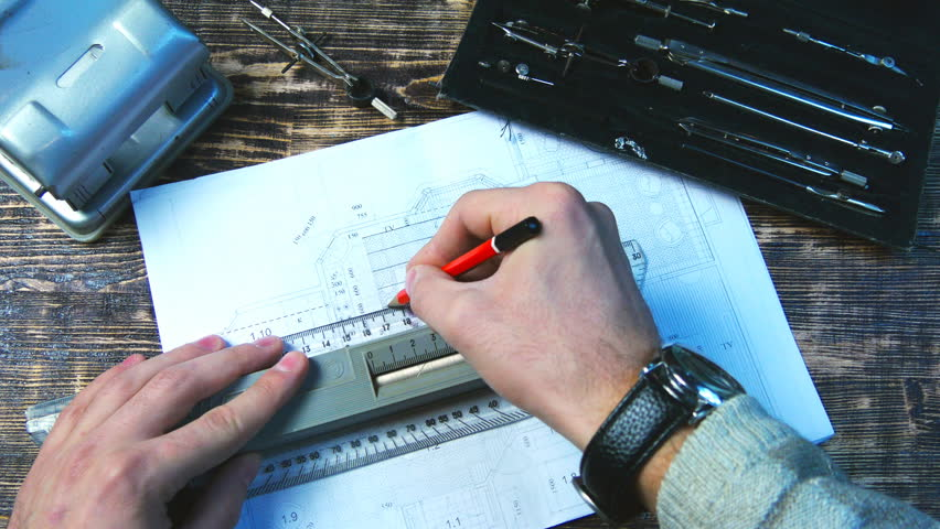 Drawing Lines In Office : Young architect drawing lines on the design project close up of