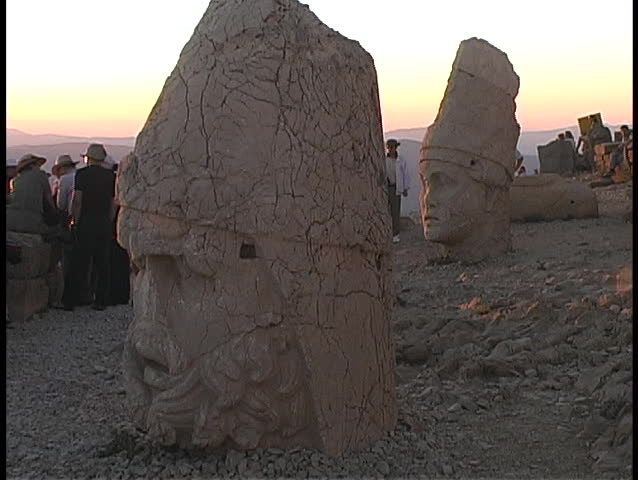The broken heads of Zeus and Antioch lie on the ground at Mount Nemrut.