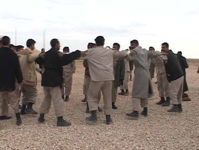 IRAQ - CIRCA 2003: Iraqi troops dance after graduation from a U.S. training academy circa 2003 in Iraq.
