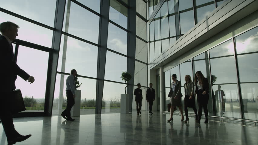 4k / Ultra HD version Three businessmen meet and shake hands in a busy modern office building on a bright day. In slow motion. Shot on RED Epic | Shutterstock HD Video #14126687