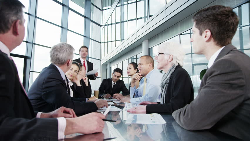 4k / Ultra HD version Attractive diverse business group in discussion in a business meeting in a large modern building with lots of natural light. Shot on RED Epic | Shutterstock HD Video #14127392