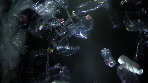 floating plastic waste in the water