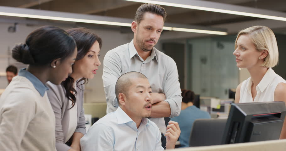 Creative business team meeting in modern glass office multi ethnic group of people working over computer screen on combined teamwork project | Shutterstock HD Video #14141801