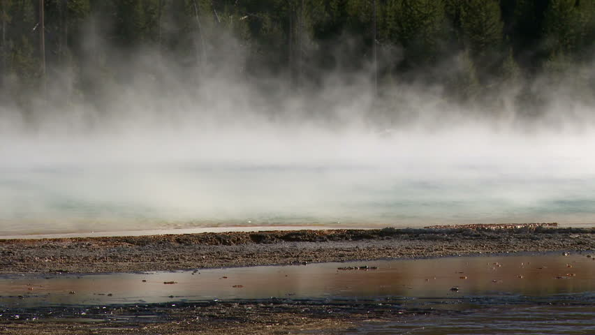 Steam blows over Grand Prismatic Spring in Yellowstone National Park