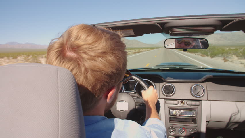 Man In Convertible Car Driving Along Open Road Shot On R3D #14169602