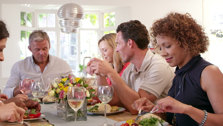 Mature Friends Around Table At Dinner Party Shot On R3D | Shutterstock HD Video #14170472