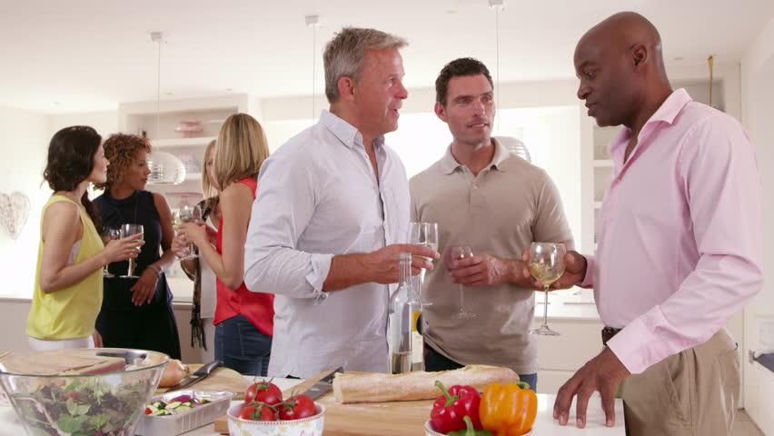 Group Of Mature Friends Enjoying Dinner Party Shot On R3D | Shutterstock HD Video #14170712