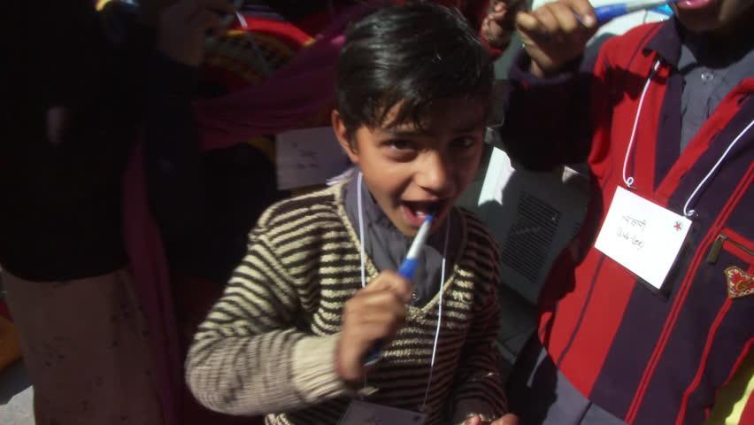 Chamba, India - CIRCA 2013 - School girls brushing teeth | Shutterstock HD Video #14196272