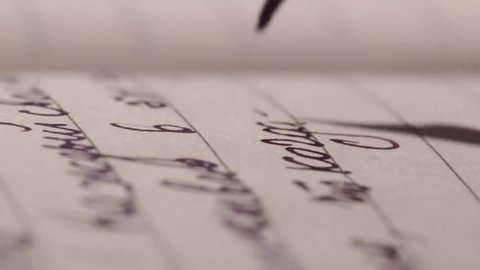 Hand Writing Ink Pen  in the Dark Room