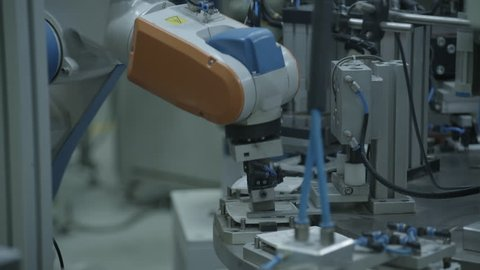Industrial robot arm in factory, close.