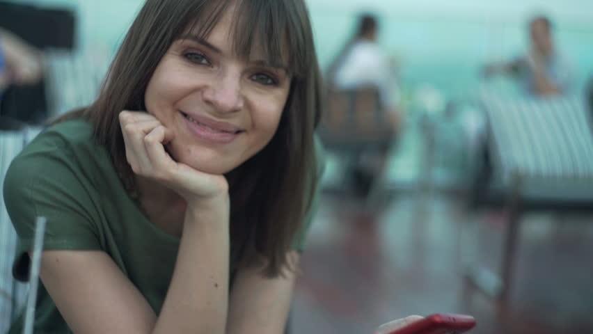 Portrait of happy pretty woman using smartphone in bar     Shutterstock HD Video #14283652