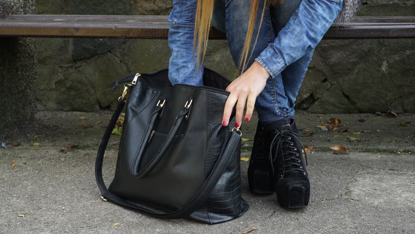 Woman in fashionable clothes with bag handbag looking for something. 4K ProRes HQ codec | Shutterstock HD Video #14291332