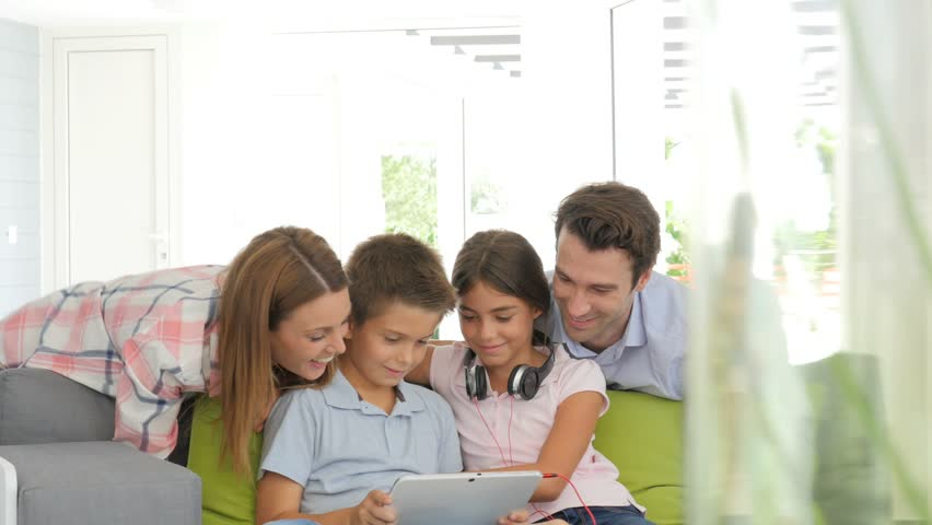 Parents watching kids websurfing with digital tablet | Shutterstock HD Video #14294482