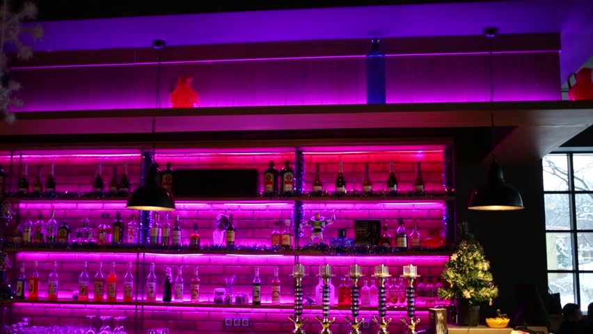 Bar with purple neon lights hookahs and lots of bottles of bar with purple neon lights hookahs and lots of bottles of alcohol stock footage video 14298562 shutterstock mozeypictures Gallery