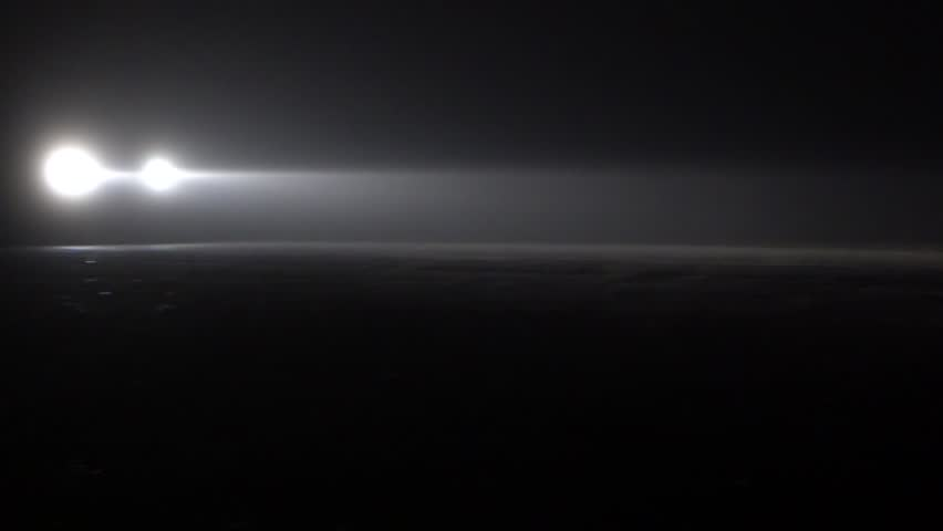 Car going on empty night road in heavy fog. In total darkness seen only the bright light of car headlights. The concept of transport and travel. | Shutterstock HD Video #14308222