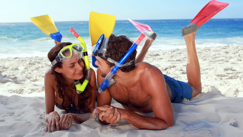 Happy Couple With Snorkeling Equipment Talking At The Beach Hd Stock Video Clip
