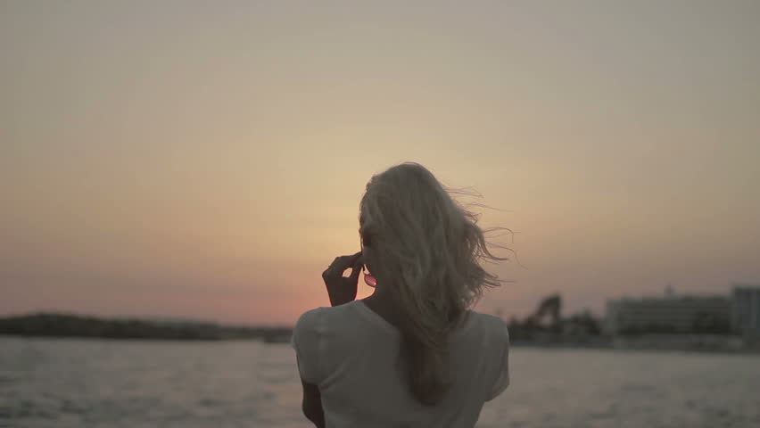 Romantic girl at sunset on the sea background #14337112