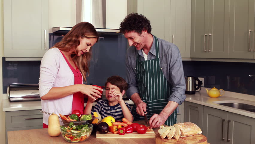 Happy family preparing vegetables together in the kitchen | Shutterstock HD Video #14340292