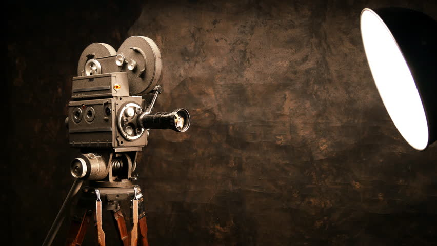 An Antique 8mm Film Projector Projects A Blank Movie With