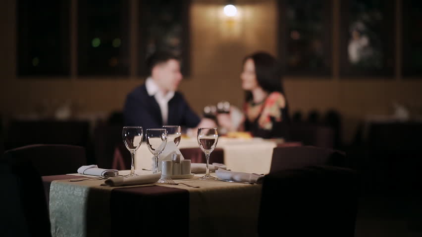 Fancy Restaurant Background close-up footage of elegantly decorated table at restaurant, woman
