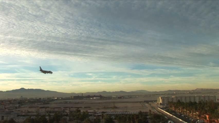 Plane descending onto Vegas airport runway | Shutterstock HD Video #1437142