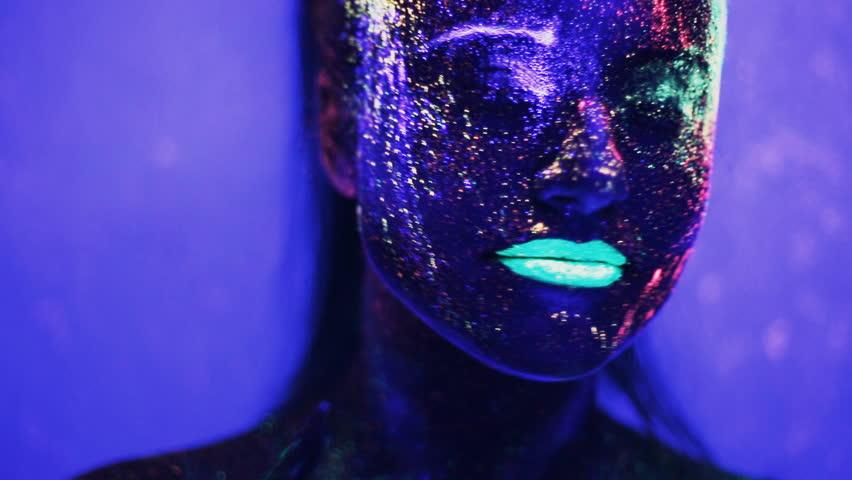 Girl dancing in the ultraviolet light   Shutterstock HD Video #14378152