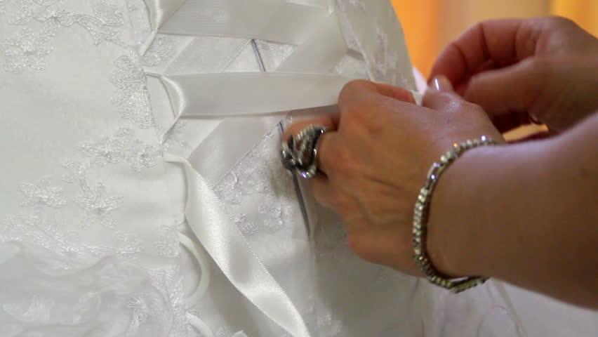 Bride dress up her wedding dress and jewelry. Three frames. | Shutterstock HD Video #1440322