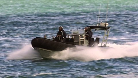 AUCKLAND, NZL - JAN 30 2016:Royal New Zealand navy sailors ride a Zodiak Rigid-hulled inflatable boat in ports of Auckland.The RNZN has a role to help prevent any unrest occurring in New Zealand.
