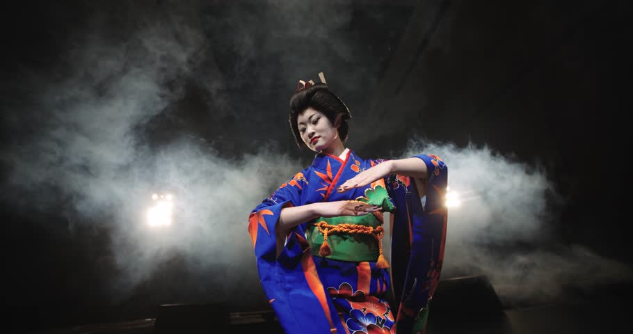 4K beautiful Japanese geisha dancing on stage and posing for the camera,the smoke in the background, slow motion #14443852