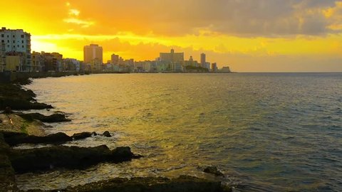 Cuba, Havana, Centro Habana, the Malecon, Vedado skyline at sunset