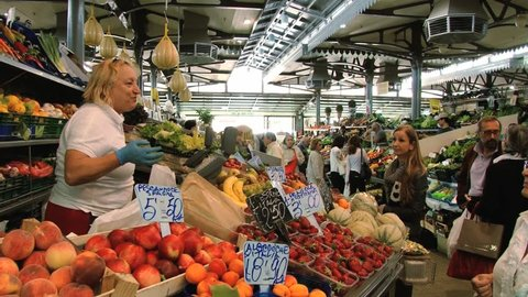 MODENA, ITALY – MAY 15, 2013: Unidentified people do shopping at the Old Market in Modena, Italy.