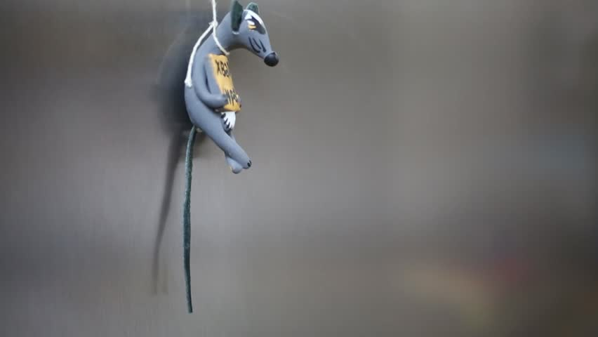 Close-up of small toy mouse on magnet hang on to piece of cheese on refrigerator door (Text: enough to eat)