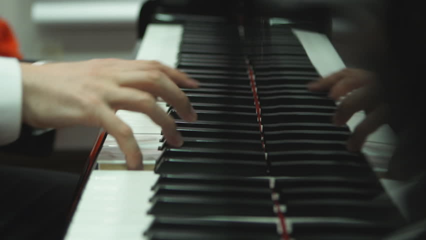 Close up hands playing the piano | Shutterstock HD Video #14566672