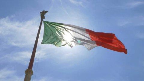 Italian flag backlit by the sun. Altare della Patria in Rome, Italy.