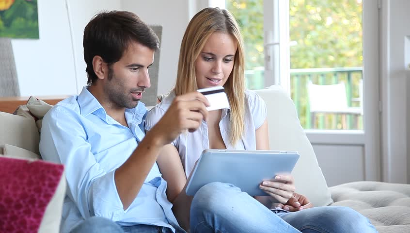 Young couple at home doing online shopping