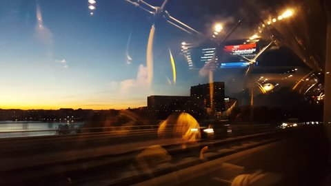 STOCKHOLM, SWEDEN, FEB 2016: Reflection of Crowd of people in a bus window with the city downtown in background