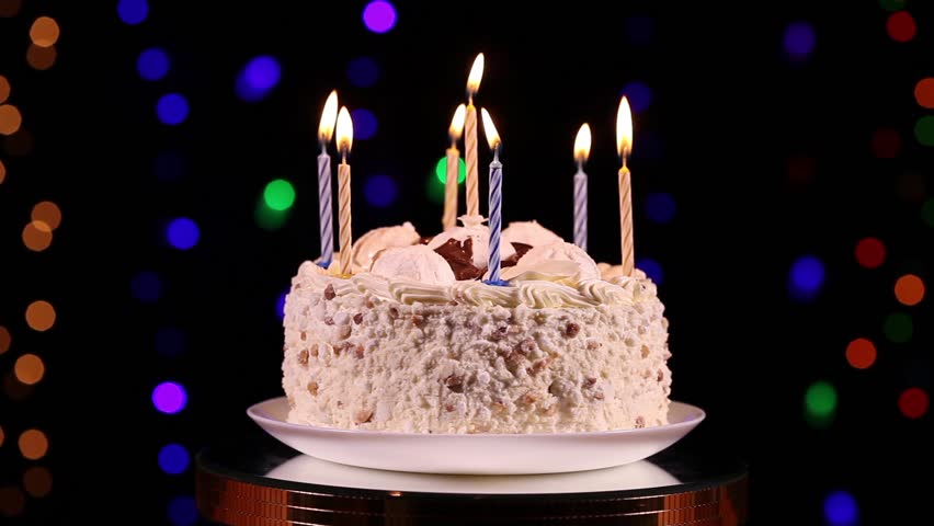 Happy Birthday Cake With Burning Candles Rotating Royalty Free Video