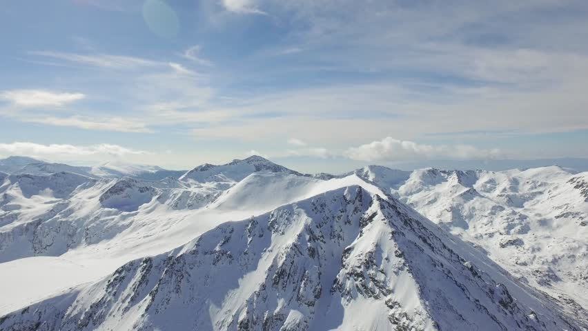 Aerial Flight Over Beautiful Mountains Alpine Mountain Ridge Rocky Peak Snow Winter Landscape Nature Outdoors Epic Adventure Inspiration Background | Shutterstock HD Video #14596432