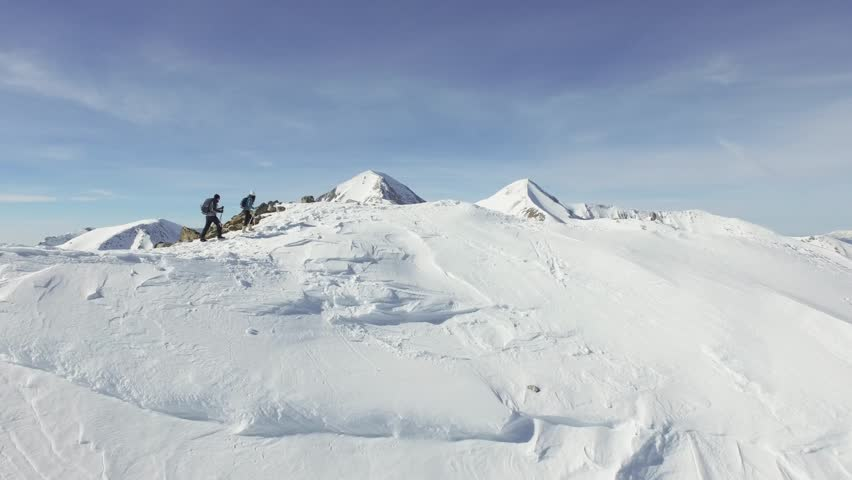 Epic Beautiful Mountain Range Couple Hiking Expedition Alps Aerial Drone Footage Ski Extreme Sports Dangerous Environment Concept | Shutterstock HD Video #14596585