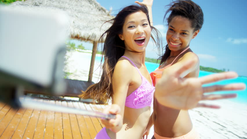 Beautiful young asian chinese girls friends enjoyment corporate beautiful african american asian chinese girls sing selfie stick on beach 4k stock footage clip voltagebd Gallery