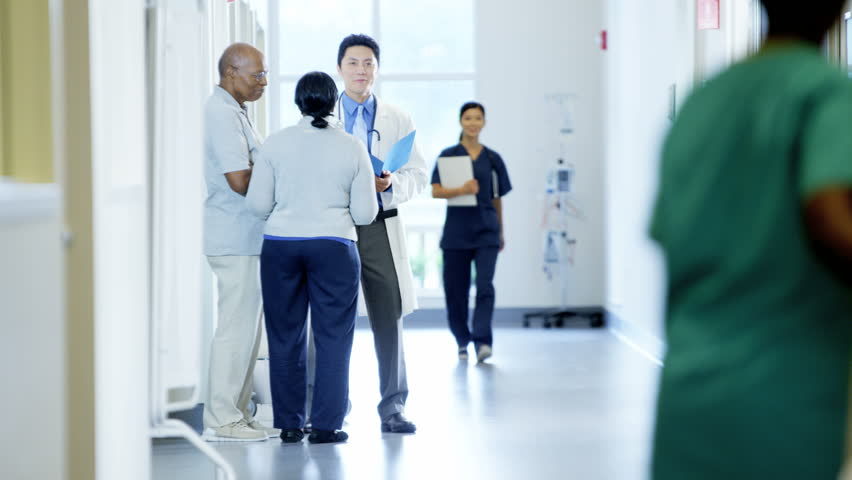 Asian American doctor male consult with couple and team work in medical center | Shutterstock HD Video #14611012