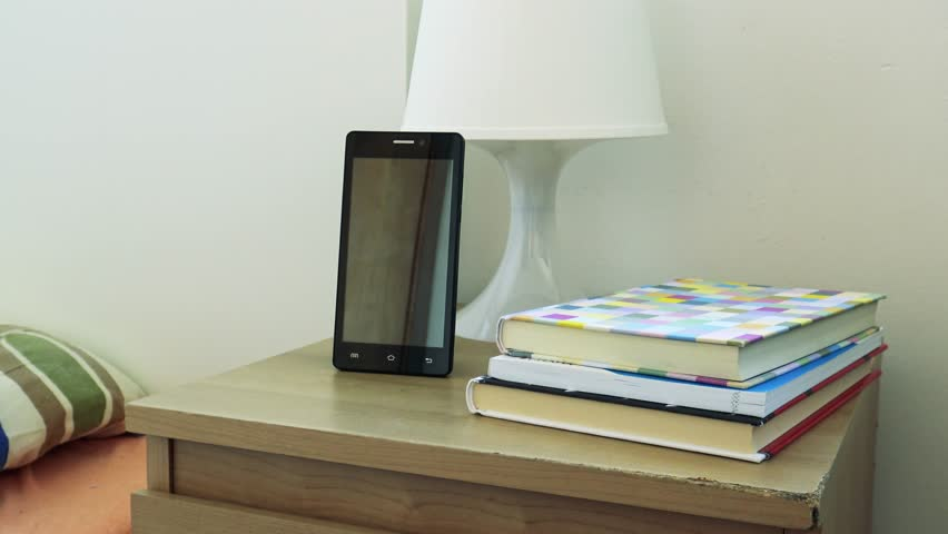 Charmant Smartphone On Bedside Table Next To The Bed In Bedroom   Books Stock  Footage Video 14611372 | Shutterstock