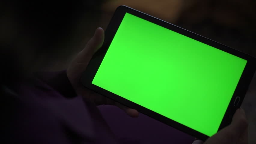 Close up green screen of a tablet on a black background. Slowly #14638402