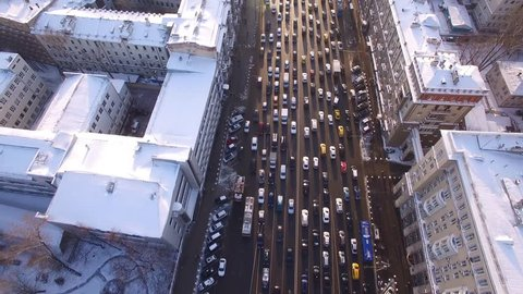 Beautiful frozen WINTER Moscow city cowered in snow and ice. From above. Road traffic jam. Aerial FPV Drone Flights. UltraHD 4K