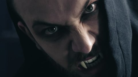 Angry dangerous vampire looking camera hungry extreme closeup