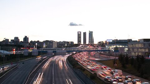 Time lapse skyline sunset city of Madrid with road and buildings
