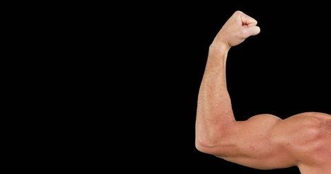 Bodybuilder posing for the camera on black background