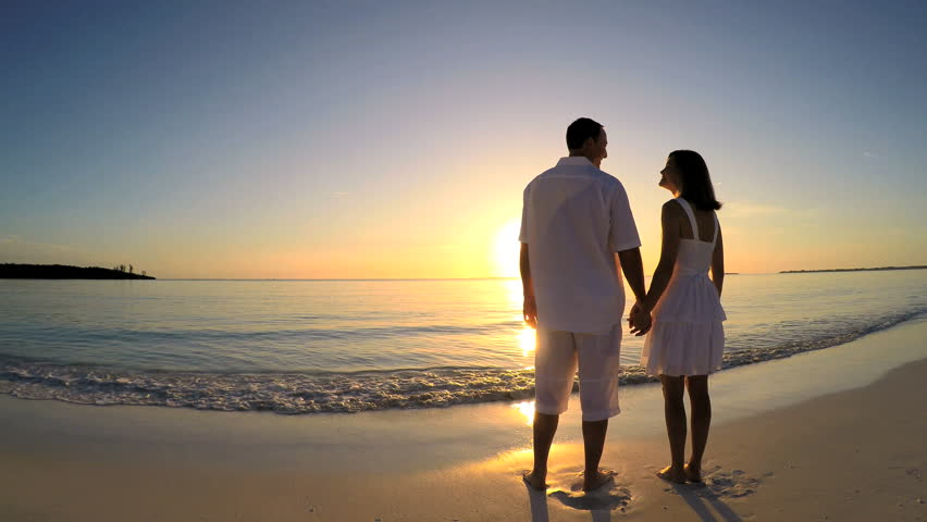 Young Caucasian Male Female Couple On Vacation Beach At Sunrise